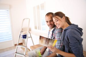 Couple,In,New,House,Choosing,Color,For,Walls